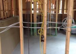 an electrician kansas city wiring a home studs