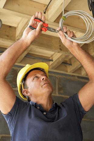 kansas city electrician installing a light fixture